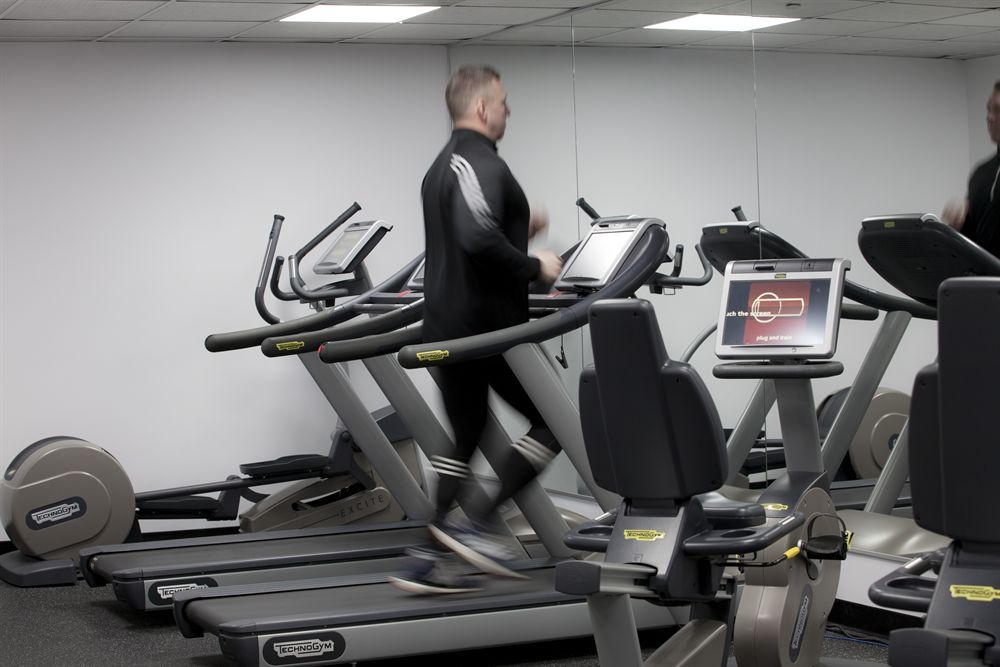 Image of a man running on a treadmill at our Montreal Hotel Fitness Center